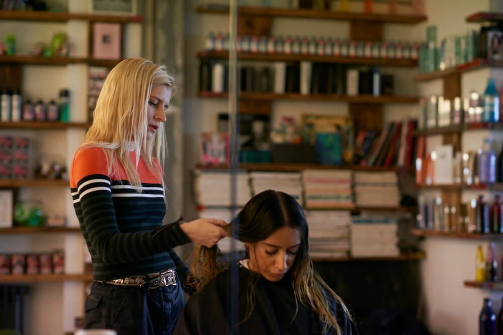 Alex Brownsell working at the Bleach London salon.