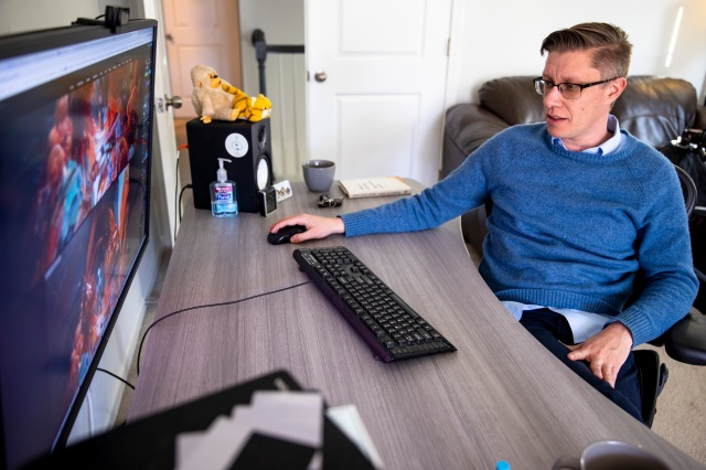 Mike Winkelmann, who goes by Beeple, shows off his digital art process in his home studio, Wednesday, Feb. 24, 2021, in Ladson, S.C. The $69.3 million March 11 online auction of a collage of 5,000 images by the artist by Christie's auction house in London catapulted Beeple's artwork into a league of the most expensive ever sold by a living artist. (Andrew J. Whitaker/The Post And Courier via AP)