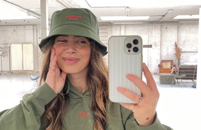 Bruna Bear sporting a hoodie and bucket hat from the Closed 24/7 unisex loungewear capsule collection.