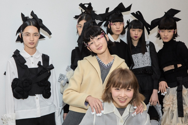 Märchen designer Chen Mei, center front, with models backstage.
