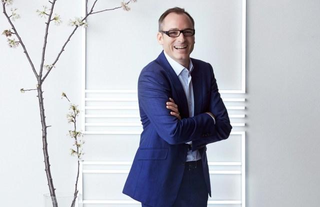 HSBC's Erwan Rambourg standing with tree