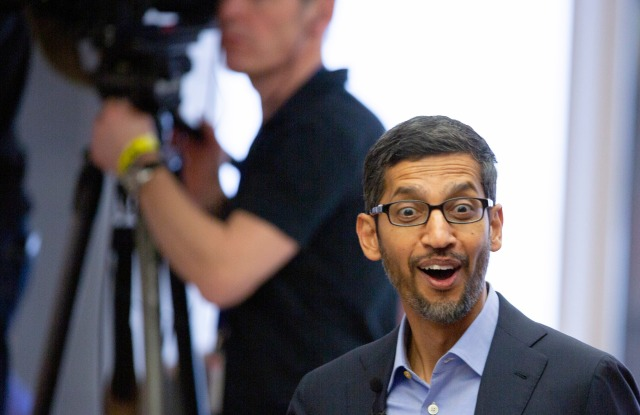 Google's chief executive Sundar Pichai arrives for an event on artificial intelligence at the Square in Brussels, Monday, Jan. 20, 2020. Google's chief executive called Monday for a balanced approach to regulating artificial intelligence, telling a European audience that the technology brings benefits but also negative consequences. (AP Photo/Virginia Mayo)