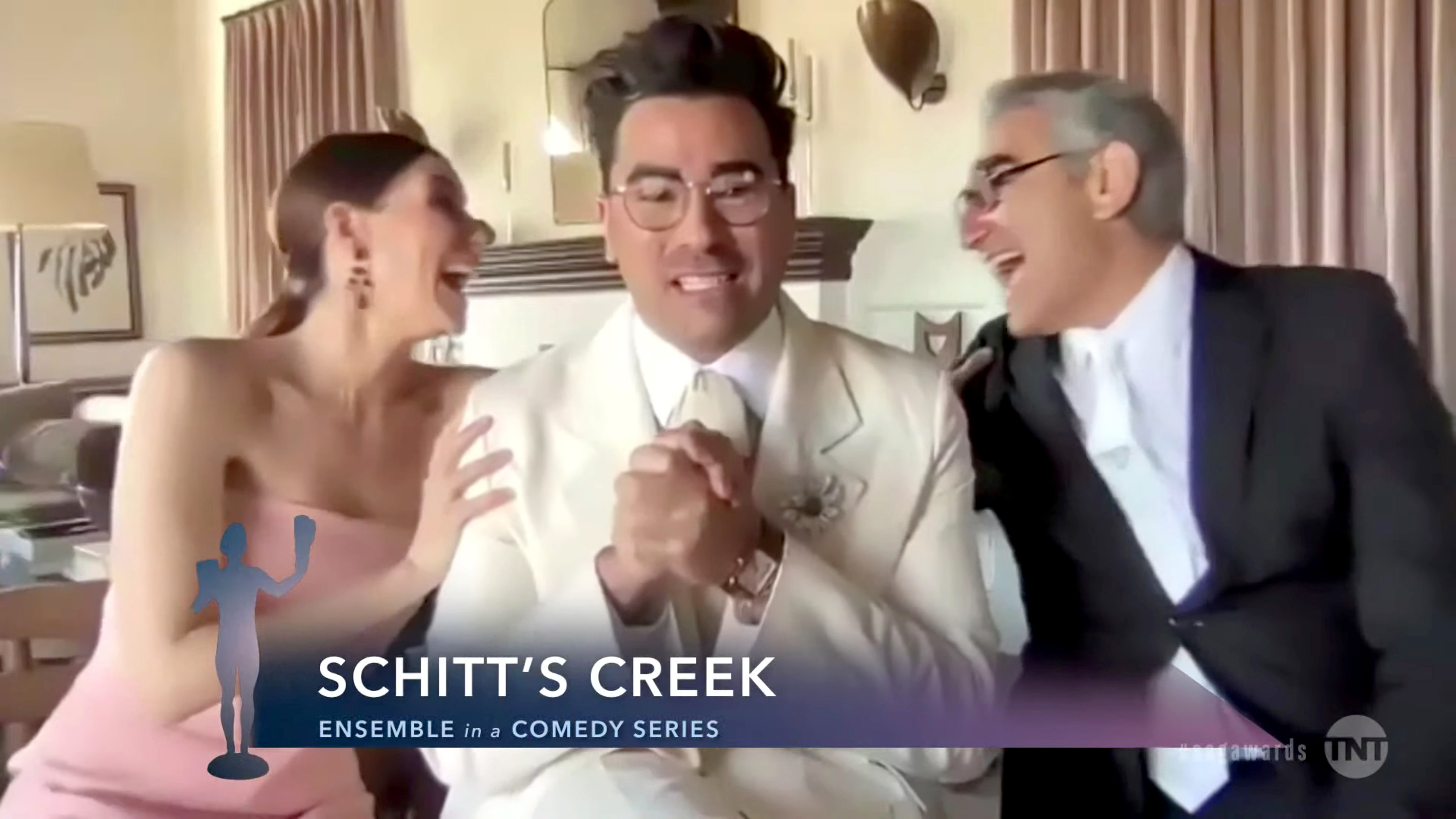 """VARIOUS CITIES - APRIL 04: (L-R) In this screengrab released on April 4, 2021, Sarah Levy, Dan Levy, and Eugene Levy, winners of Outstanding Performance by an Ensemble in a Comedy Series for """"Schitt's Creek"""", speak during the 27th Annual Screen Actors Guild Awards on April 04, 2021. (Photo by 27th Annual SAG Awards/Getty Images for WarnerMedia)"""