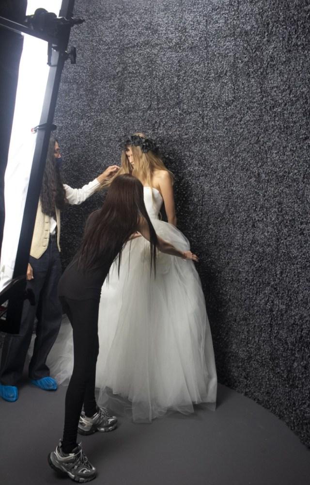 Vera Wang adjusts a Vera Wang Bride dress for a photo shoot.
