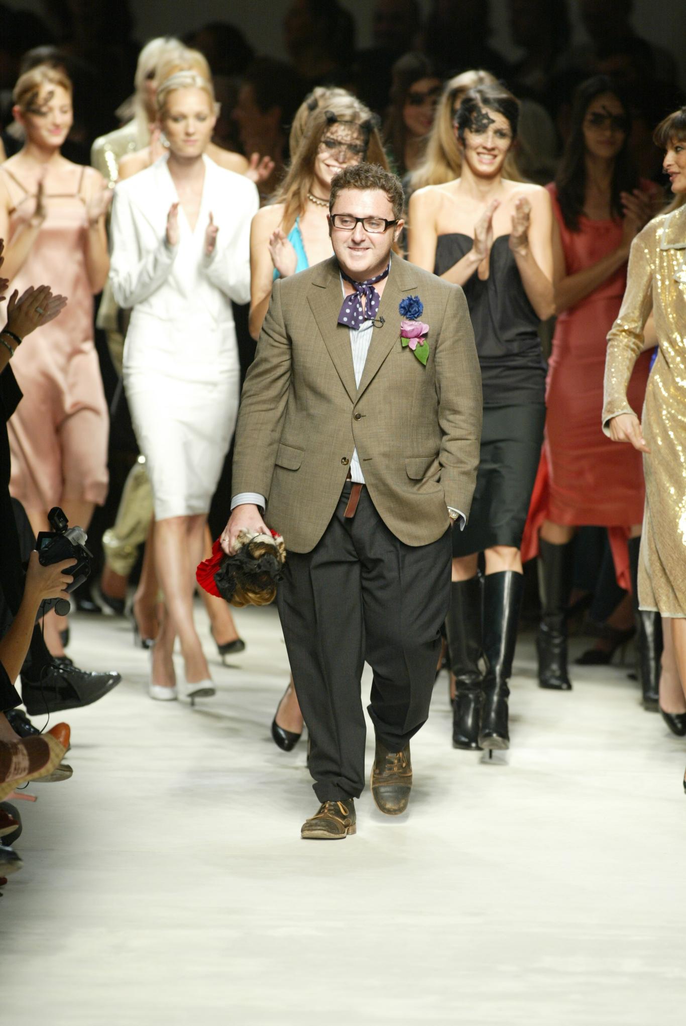 Designer Alber Elbaz walks down the runway at the Spring 2004 Lanvin show in Paris.