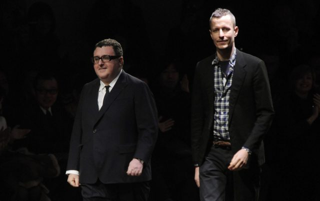 Designers Alber Elbaz and Lucas Ossendrijver on the runway after Lanvin's fall 2011 menswear show at Palais de Tokyo.