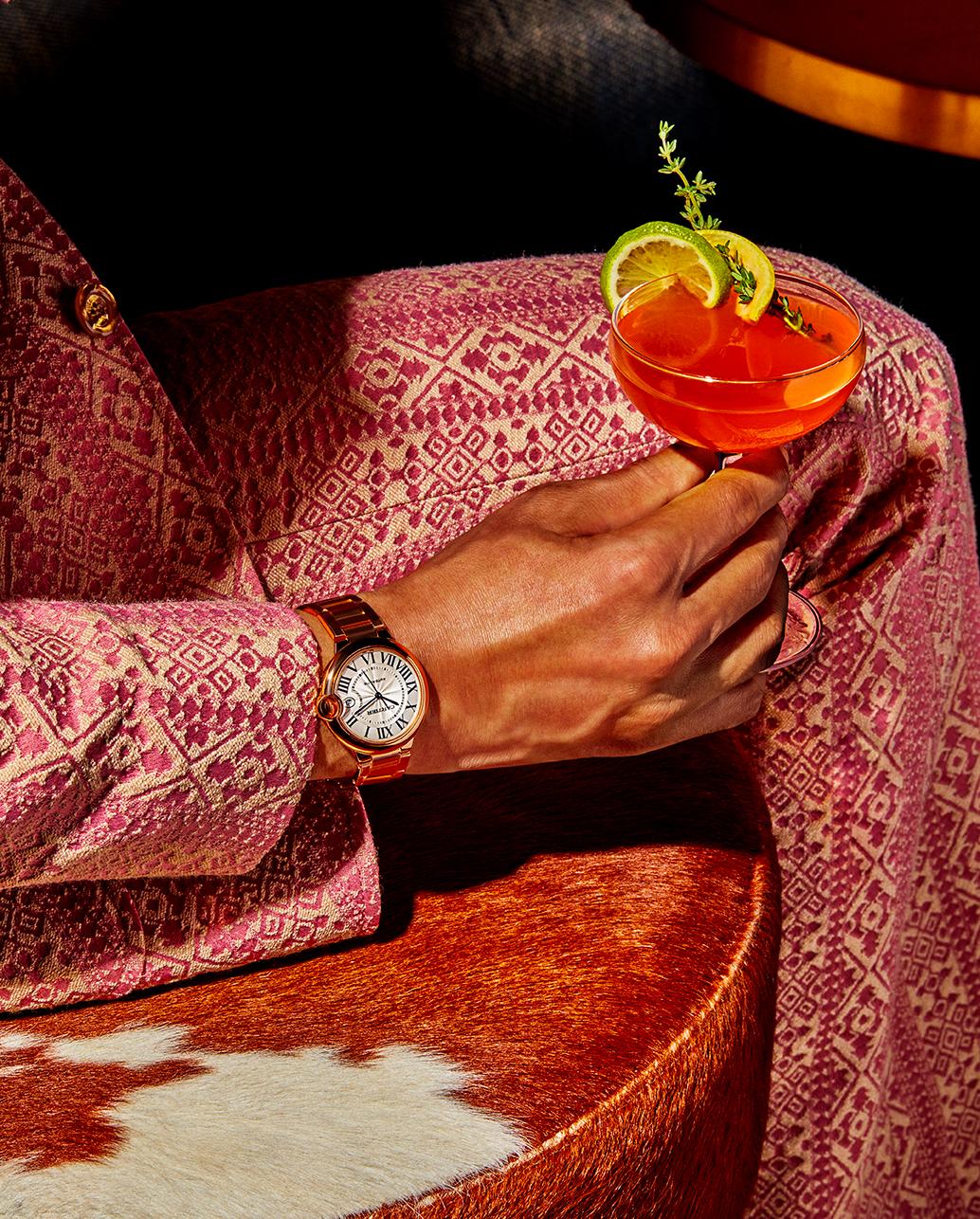 Ballon Bleu de Cartier's watch, 18-karat rose gold, 40 mm. Cartier Love 18-karat rose gold bracelet. Gucci wool suit. Firetip drink