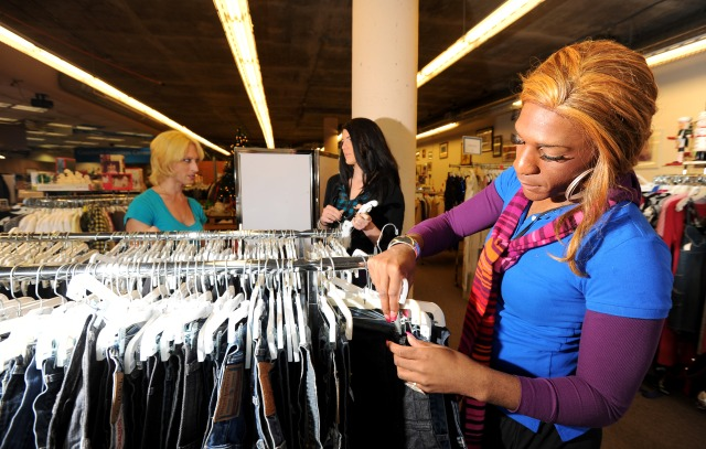 In this Nov. 26, 2010 photo, Octavia Williams arranges merchandise at the Castro Goodwill in San Francisco. Seven of the shop's nine employees are transgender, most of them women who used to be men. They were referred to Goodwill by the Transgender Economic Empowerment Initiative, a nonprofit training and employment service that also places workers with Macy's, Trader Joe's, Bank of America and other supportive companies. (AP Photo/Noah Berger)