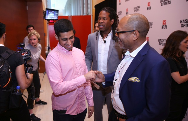IMAGE DISTRIBUTED FOR HASHTAG SPORTS - Omar Raja, left, creator of House of Highlights on Instagram, greets journalists LZ Granderson and Kevin Merida at the Hashtag Sports 2018 conference on Wednesday, June 27, 2018, in New York. (Kevin Hagen/Hashtag Sports via AP Images)