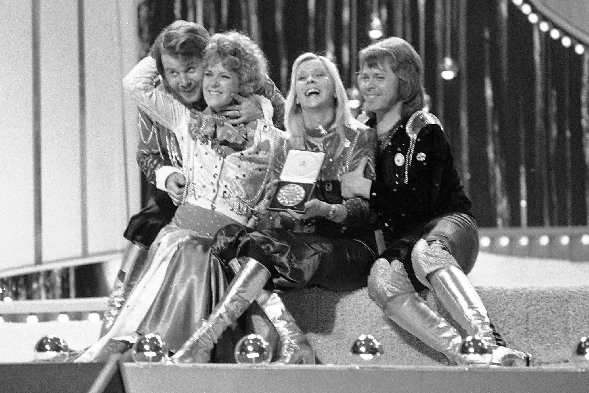 Swedish pop group ABBA celebrate winning the 1974 Eurovision Song Contest on stage at the Brighton Dome in England.