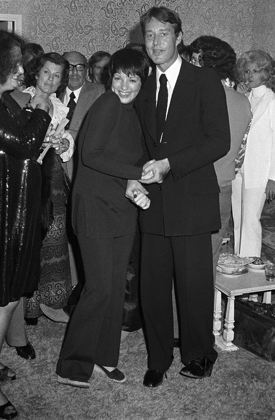 Entertainer Liza Minnelli and Roy Halston attend a showing of his spring collection in Las Vegas on October 24, 1972.