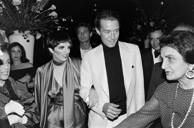 Liza Minnelli (3rd from L) and Halston (C) attend a party, benefitting the Martha Graham Center for Contemporary Dance, at Studio 54 in New York City on June 22, 1978.