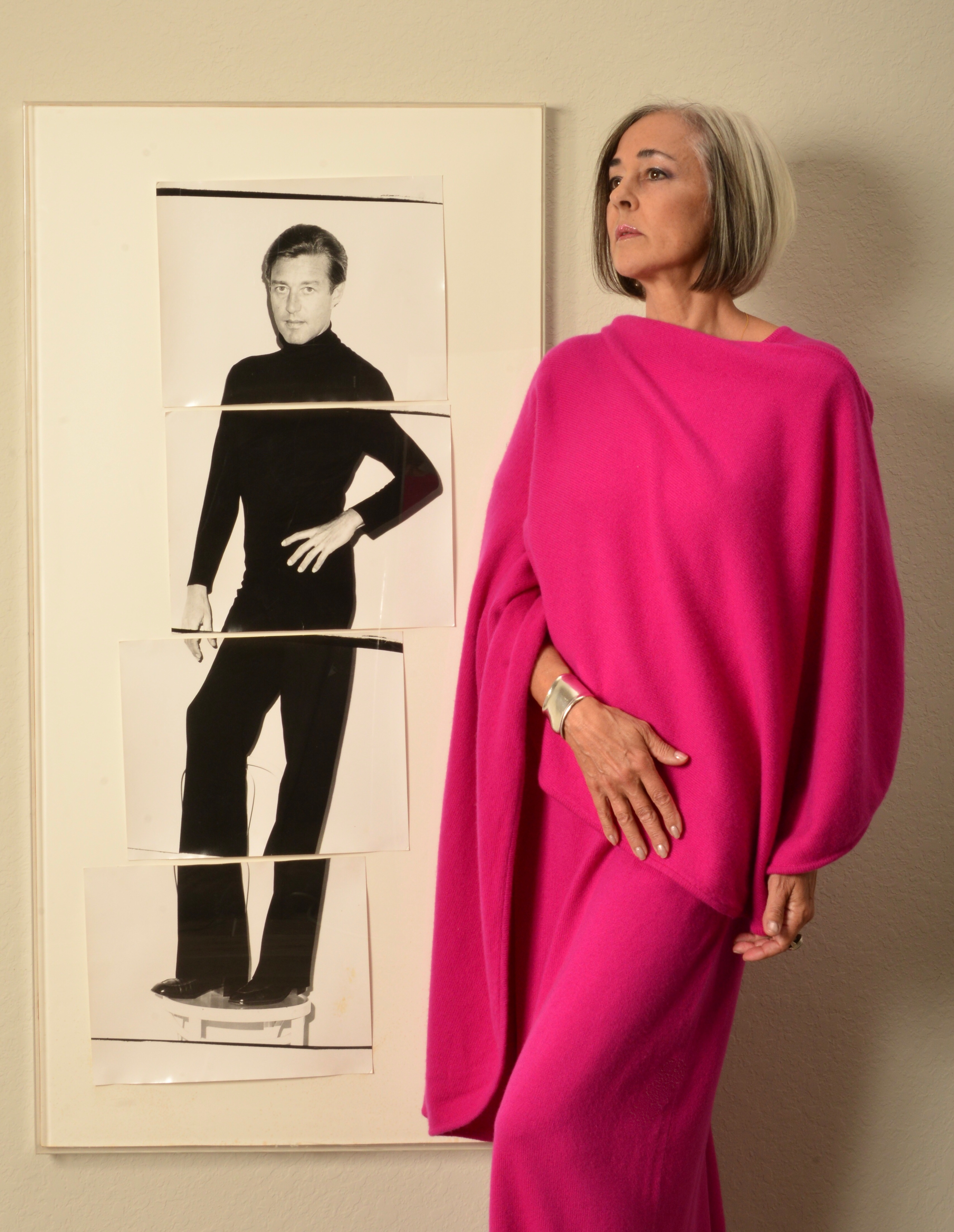 Lesley Frowick beside a photo of her uncle Halston.