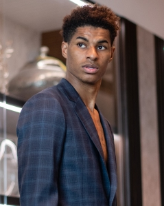 MANCHESTER, ENGLAND - MAY 16: Marcus Rashford of Manchester United takes part in a Paul Smith suit fitting at Aon Training Complex on May 17, 2021 in Manchester, England. (Photo by Ash Donelon/Manchester United via Getty Images)