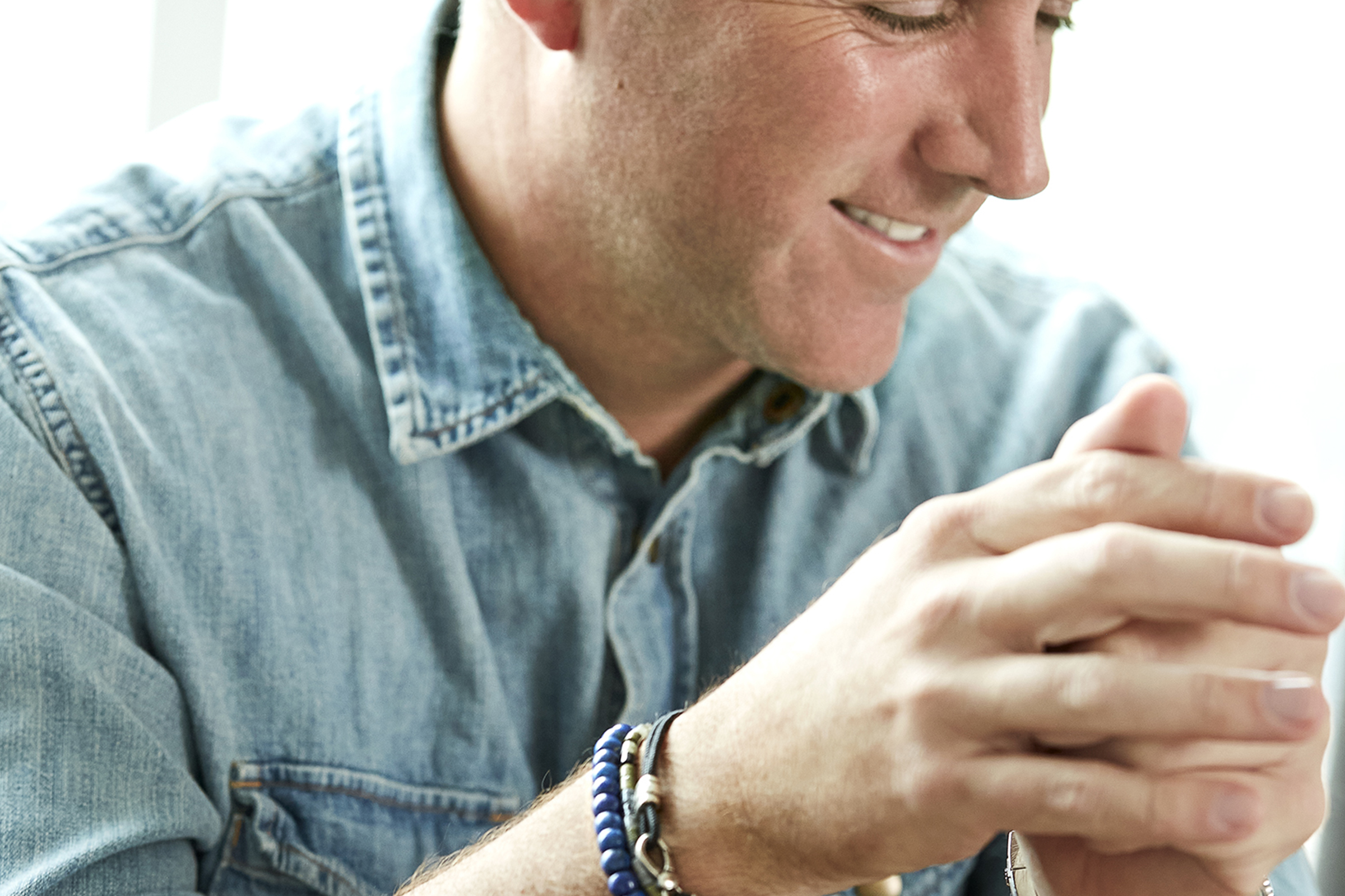 Kendra Scott chief executive officer Tom Nolan wearing Scott Bros. by Kendra Scott in a brand campaign.