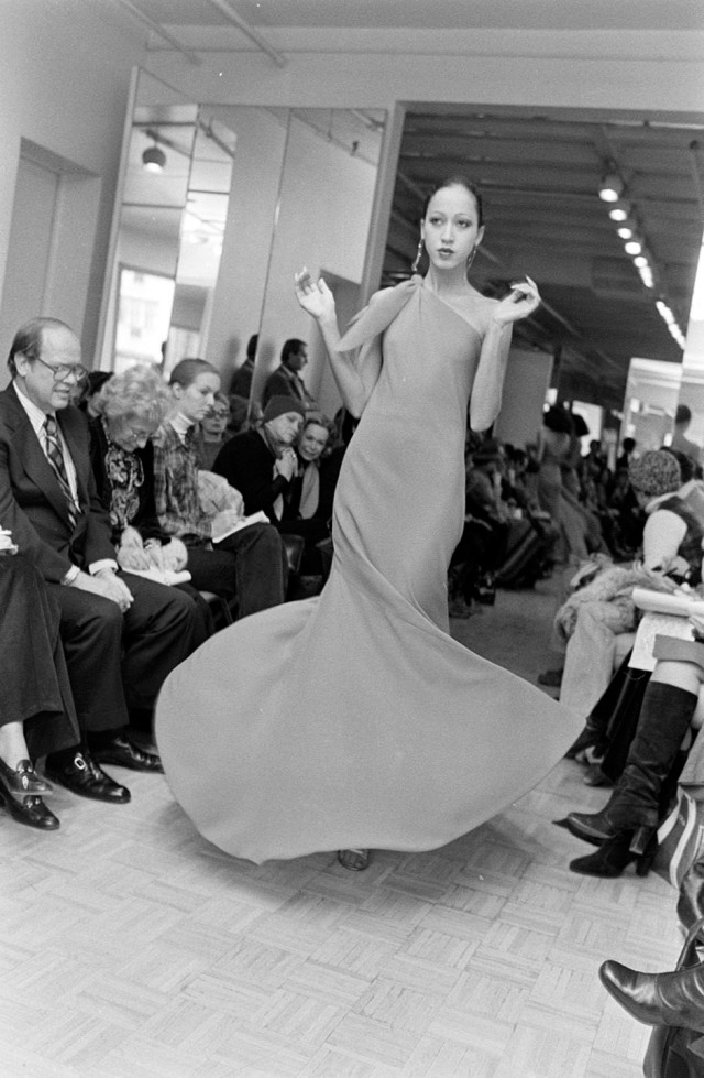 Model Pat Cleveland poses in a one-shoulder godet-skirted dance dress from Halston's spring 1977 made-to-order collection.