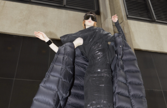 Rick Owens' nylon coat, stretch denim dress, jersey T-shirt and cotton mask. Moncler glasses; Chanel bracelet.