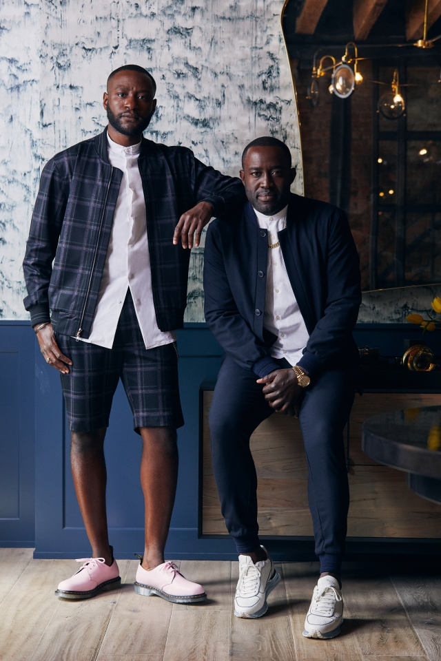 """Actor Michael Oloyede in June79 plaid blazer and shorts; Shawn Pean in June79 """"Essentials"""" navy jacket and trousers."""