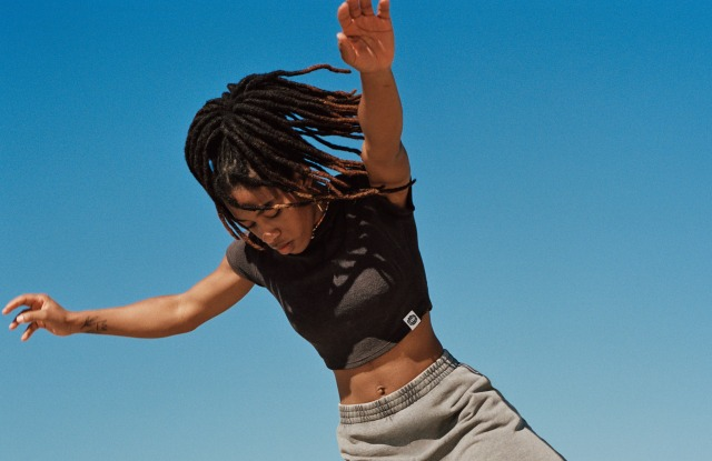 Members of Black Girls Skate are featured in an editorial in the H&M magazine. Here, a skater wears styles from the skate and surf line.