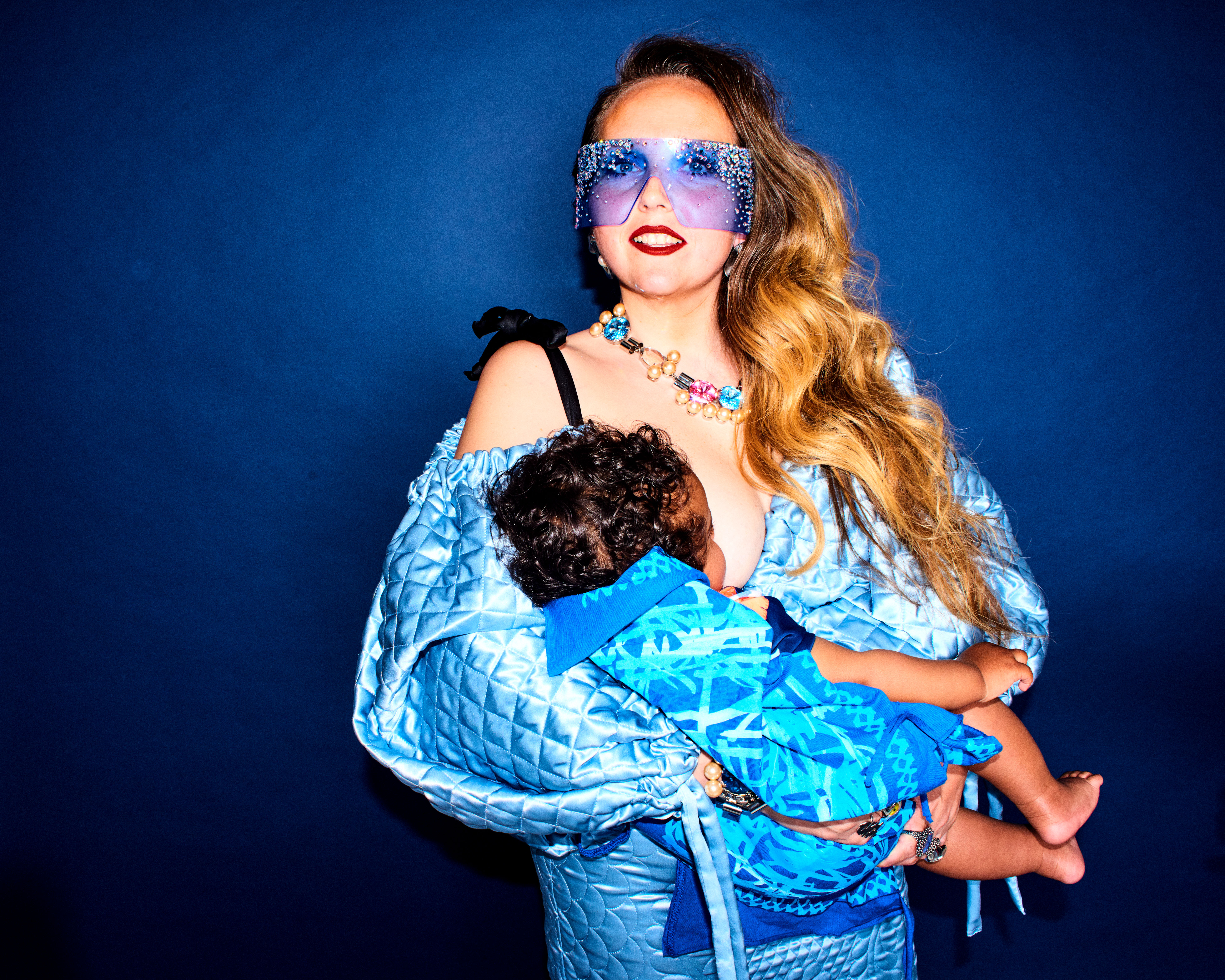 The British stylist Kim Howells with her son Indigo in the latest issue of Hunger magazine wearing a dress by Moncler.