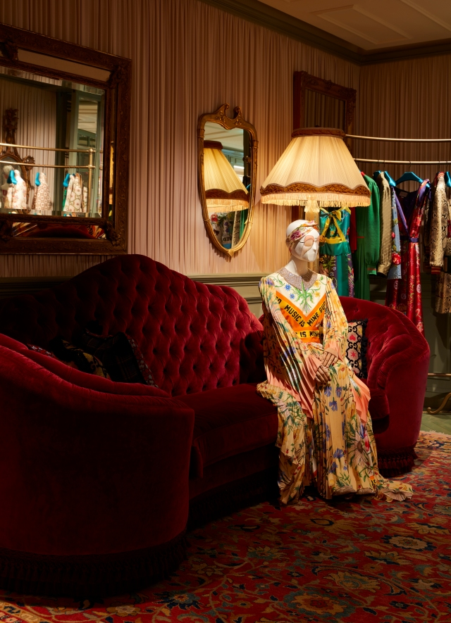Gucci teases 100th anniversary collection at Milan flagship during fashion week.