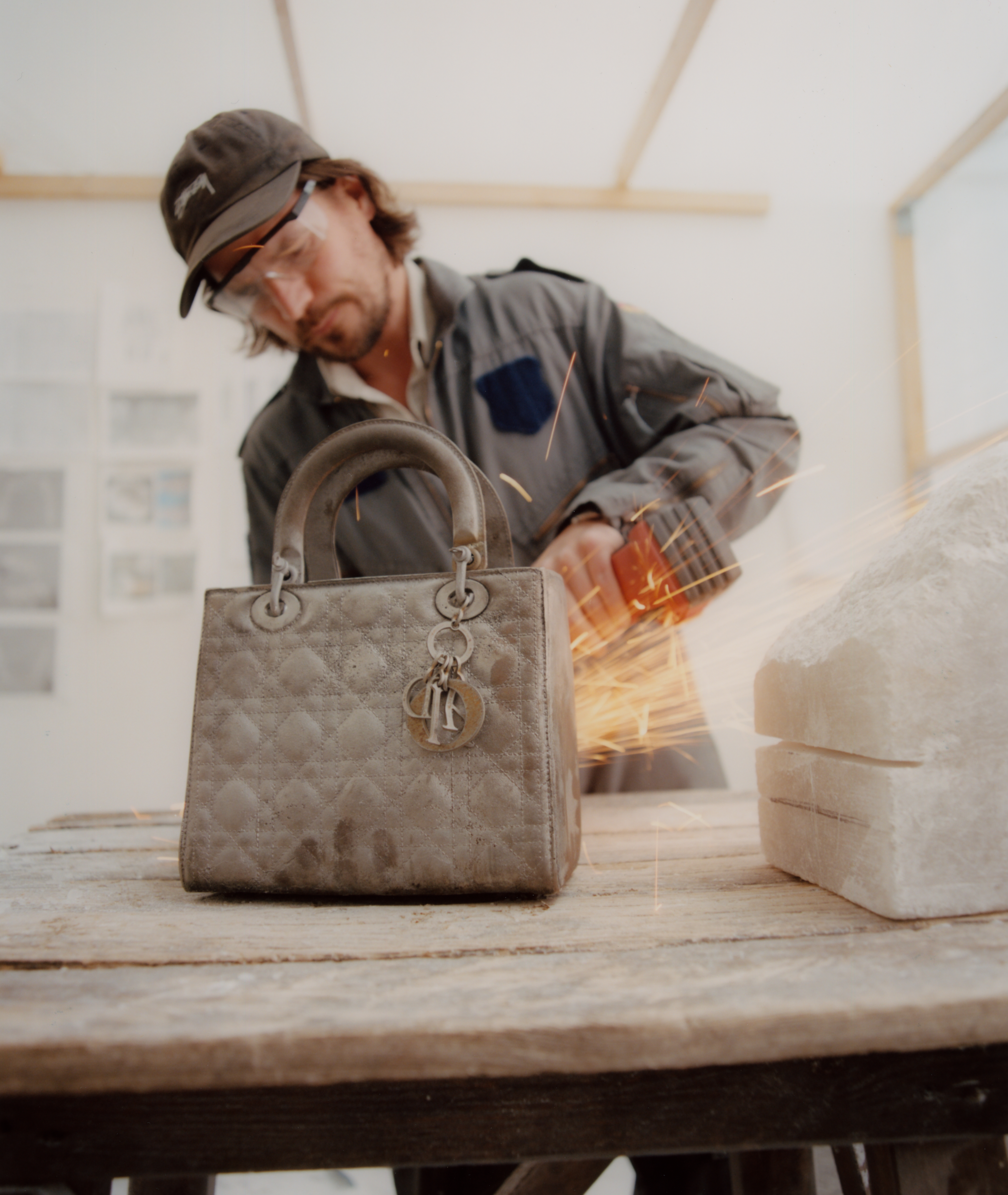 Michael-Sailstorfer at work on his iron Lady Dior.