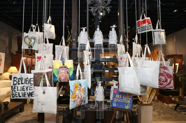 """WEST HOLLYWOOD, CALIFORNIA - MAY 26: View of a bags that various celebrities designed in collaboration with Ministry Of Tomorrow and Church Boutique as part of """"Art For Education"""" Collection at CHURCH Boutique on May 26, 2021 in West Hollywood, California. (Photo by Jerritt Clark/Getty Images for Ministry of Tomorrow )"""
