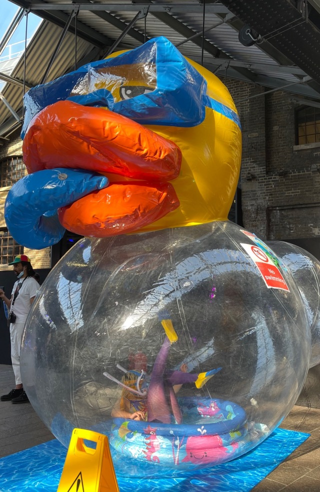 Plastic duck installation by Xavier Chen.