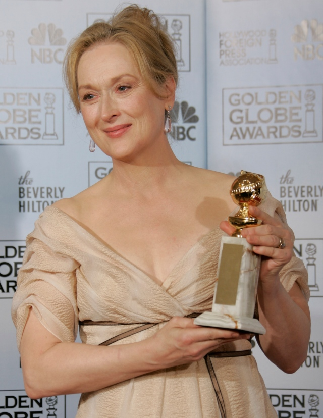 Meryl Streep poses with the award she won for best actress in a musical or comedy for her work in