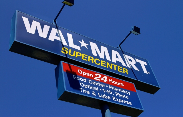 FILE - In this May 16, 2011 file photo, the WalMart Supercenter signage is seen in Springfield, Ill. Wal-Mart Stores Inc. is reporting Tuesday, Feb. 21, 2012, a 4.2 percent decline in fourth-quarter profits. But the world's largest retailer's U.S. namesake business continued its rebound as its grabbed shoppers over the critical holidays. (AP Photo/Seth Perlman, File)
