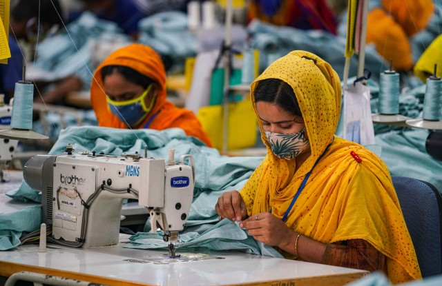 Garment workers work in a sewing section of the MG Niche Stitch Limited in Gazipur. (Photo by Zabed Hasnain Chowdhury / SOPA Images/Sipa USA)(Sipa via AP Images)