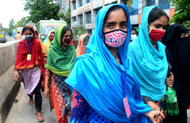 Garments workers of K Text Industrial Company Limited held a protest rally against worker harassment in their factory in Dhaka, Bangladesh, on May 21, 2021. (Photo by Mamunur Rashid/NurPhoto via AP)