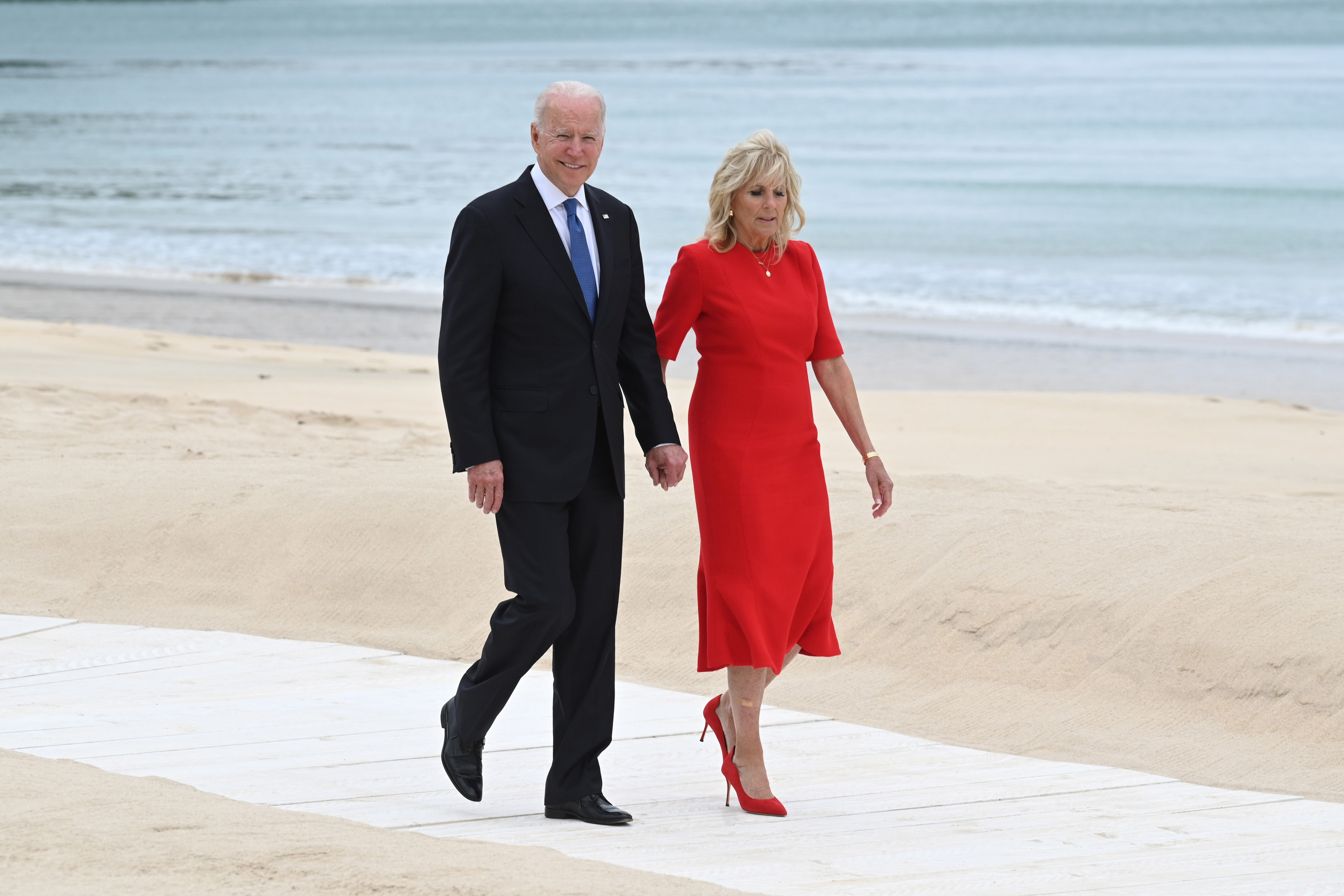 G7 Summit. US President Joe Biden and US First Lady Jill Biden, arrive for the leaders official welcome and family photo, during the G7 summit in Cornwall. Picture date: Friday June 11, 2021. See PA story POLITICS G7. Photo credit should read: Leon Neal/PA Wire URN:60304198 (Press Association via AP Images)