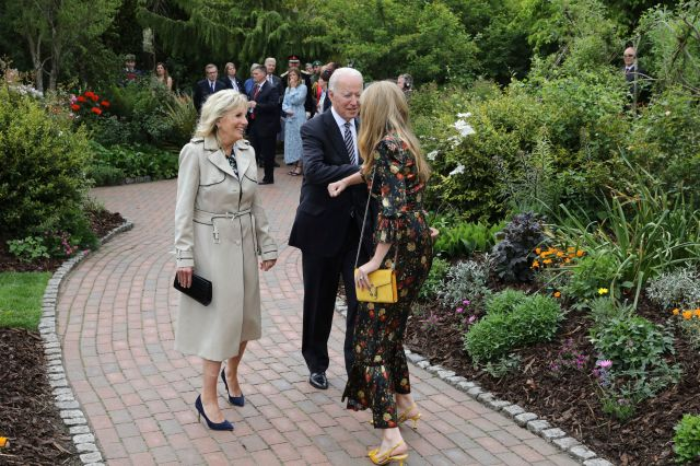 Carrie Johnson, wife of Britain's Prime Minister Boris Johnson, greets US President Joe Biden and his wife Jill Biden at a reception with the G7 leaders at the Eden Project in Cornwall, England, Friday June 11, 2021, during the G7 summit. (Jack Hill/Pool via AP)