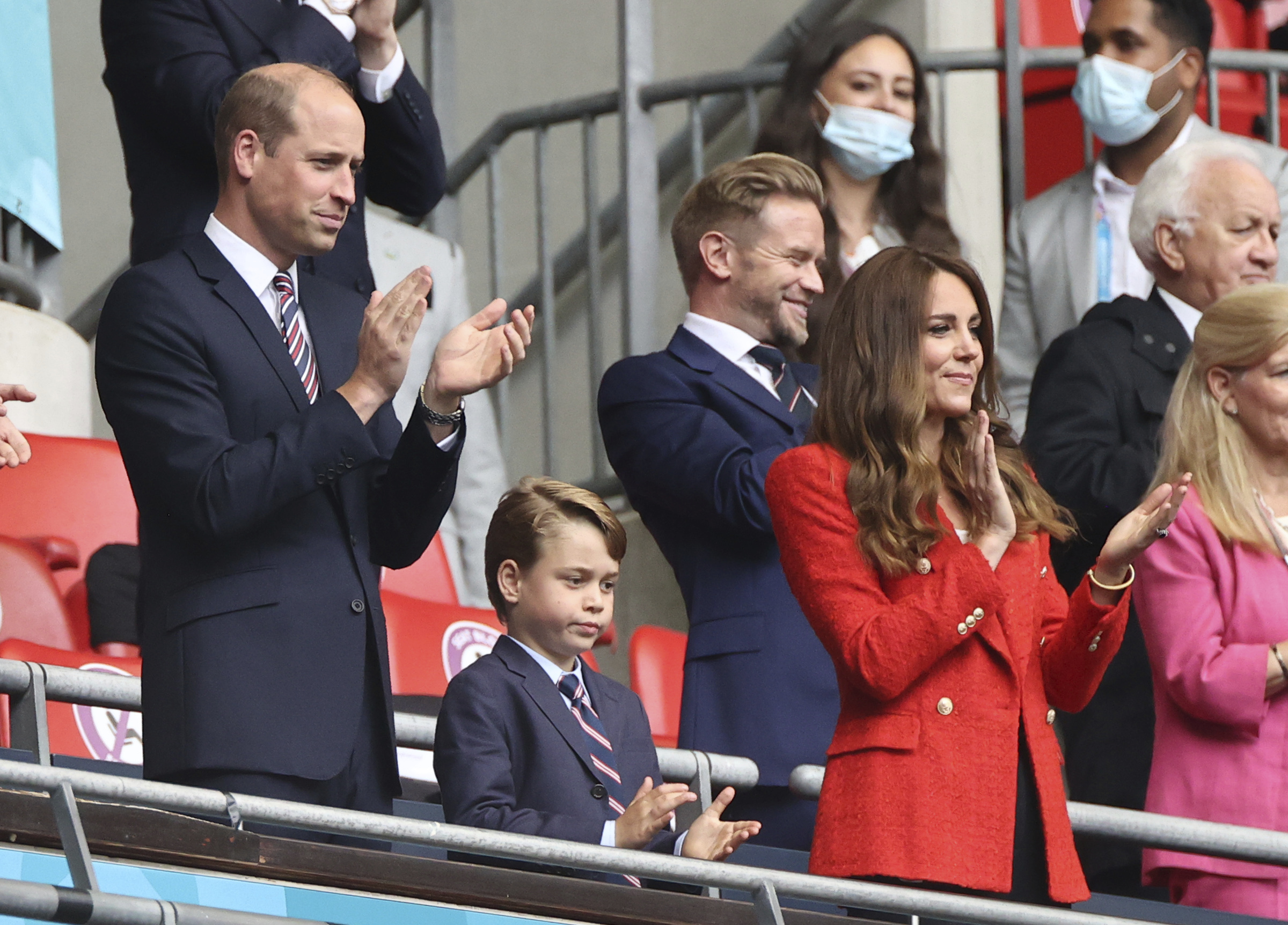 29 June 2021, United Kingdom, London: Football: European Championship, England - Germany, final round, round of 16 at Wembley Stadium. The British Prince William, Duke of Cambridge stands with his wife Kate, Duchess of Cambridge, and their son Prince George in the stands. Photo by: Christian Charisius/picture-alliance/dpa/AP Images
