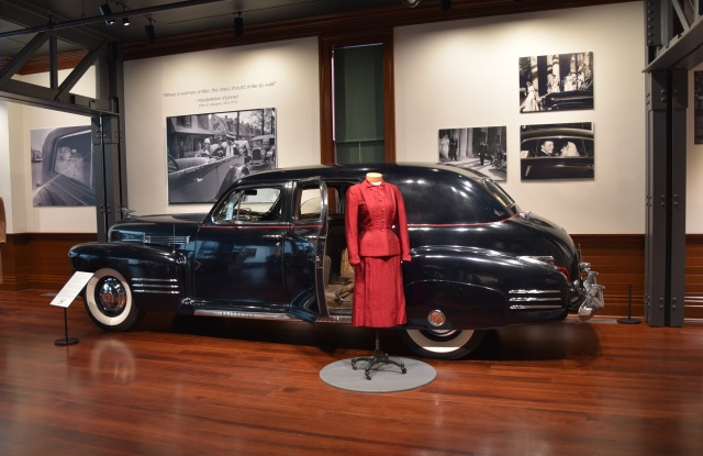 Pictured here is a 1941 Cadillac Series 67 Vanderbilt Limo paired with a tailored red silk suit belonging to Hattie Carnegie of New York.