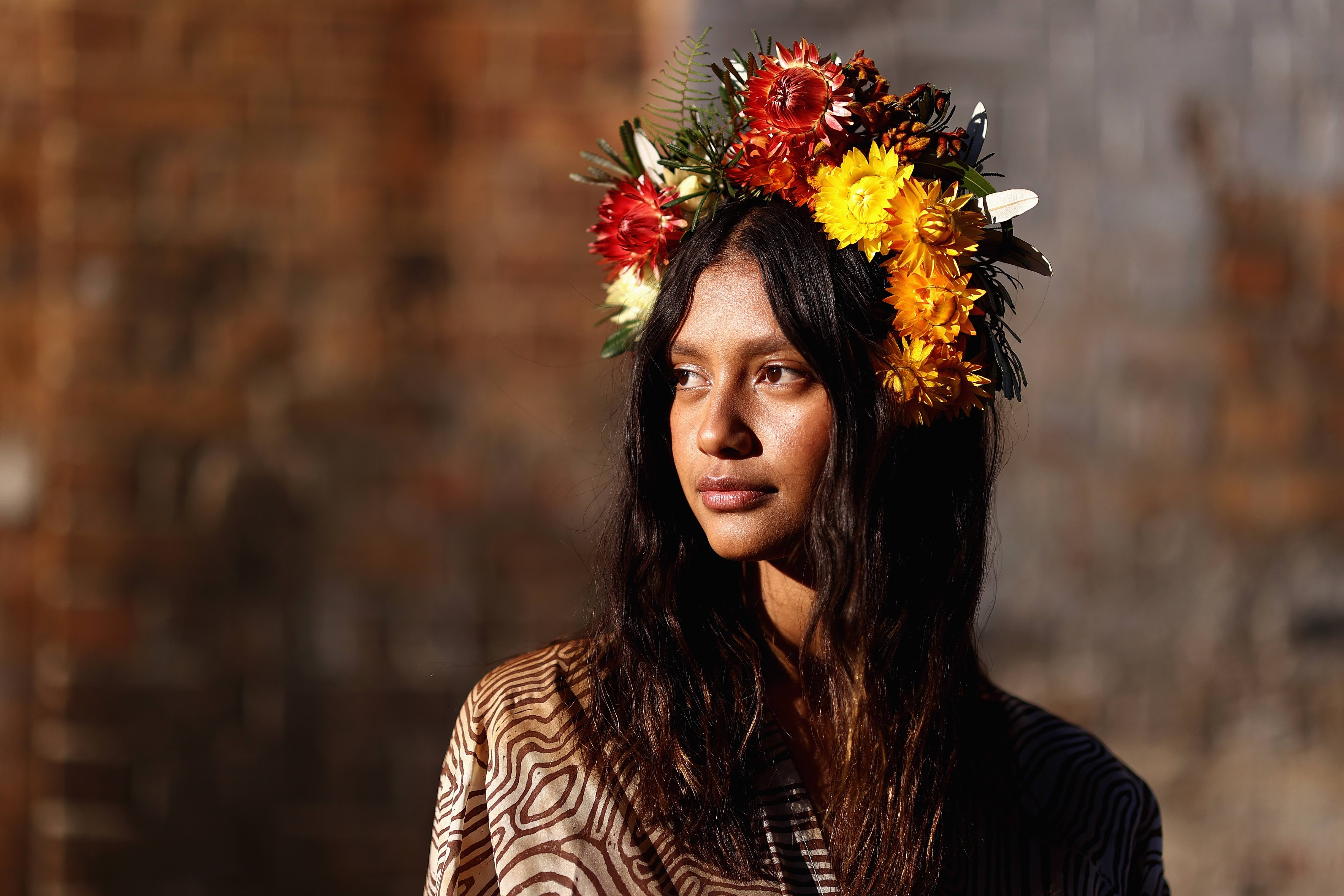 SYDNEY, AUSTRALIA - MAY 31: Indigenous model Lisa Fatnowna poses at the Welcome To Country for Afterpay Australian Fashion Week 2021 at the Blacksmith's Workshop, Carriageworks on May 31, 2021 in Sydney, Australia. (Photo by Cameron Spencer/Getty Images)