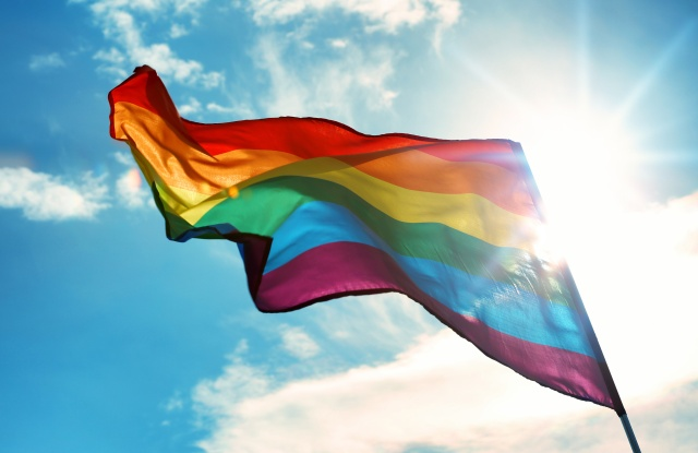 pride flag on sky background