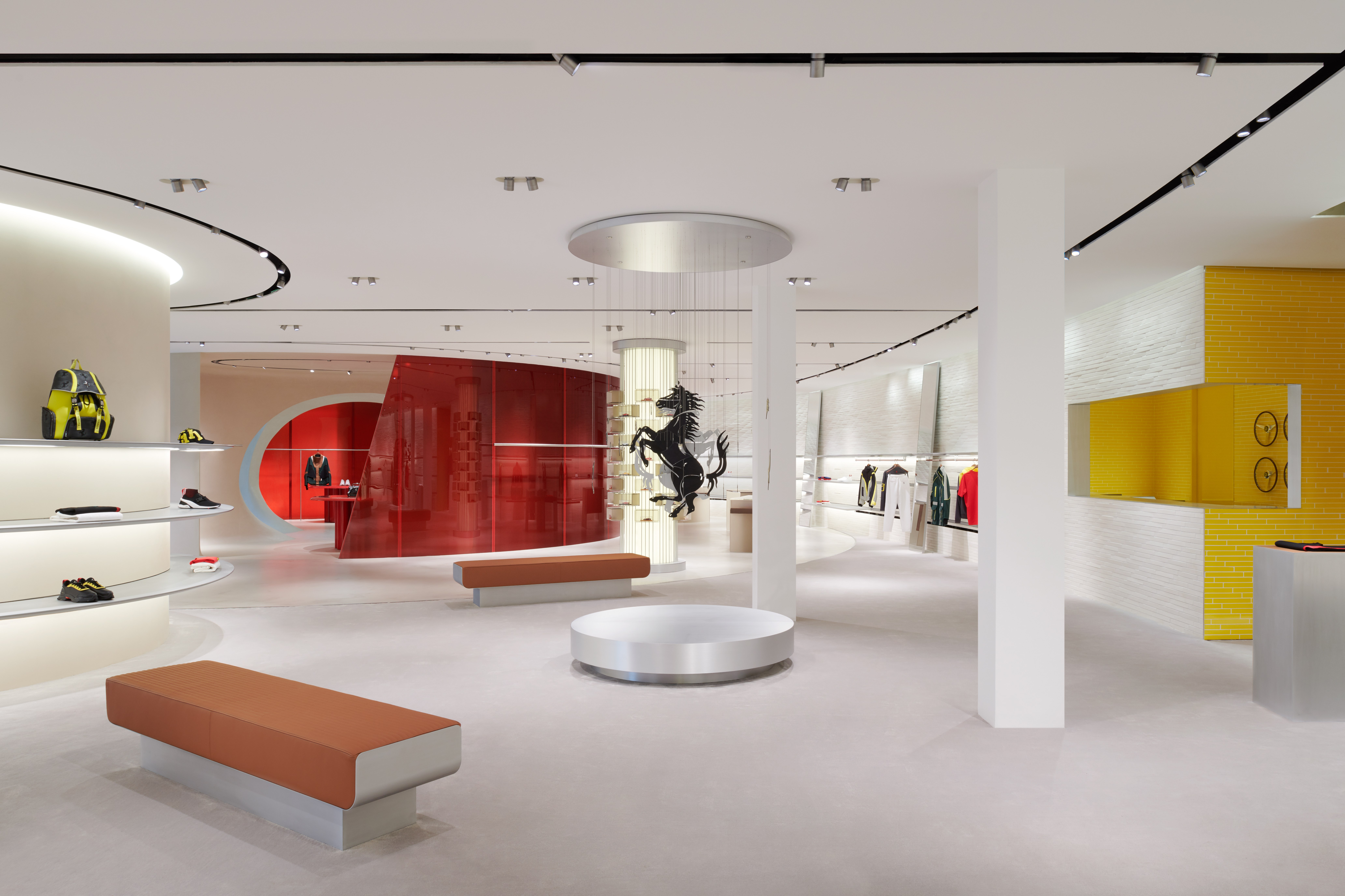 A first look at the new Ferrari store concept in Maranello, designed by Sybarite.