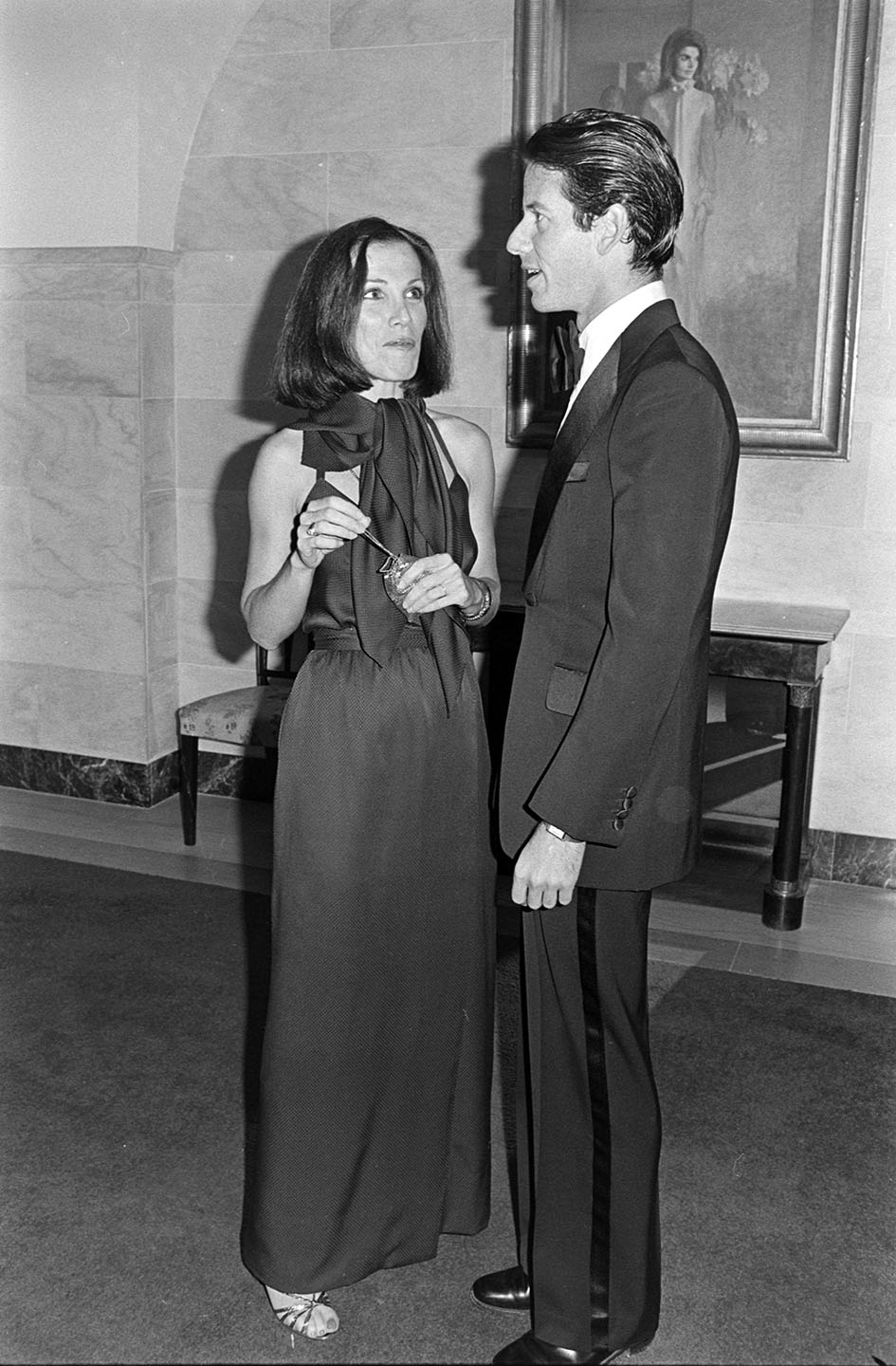 Frances Stein and Calvin Klein attend an event at the White House in Washington, D.C., on October 14, 1976.
