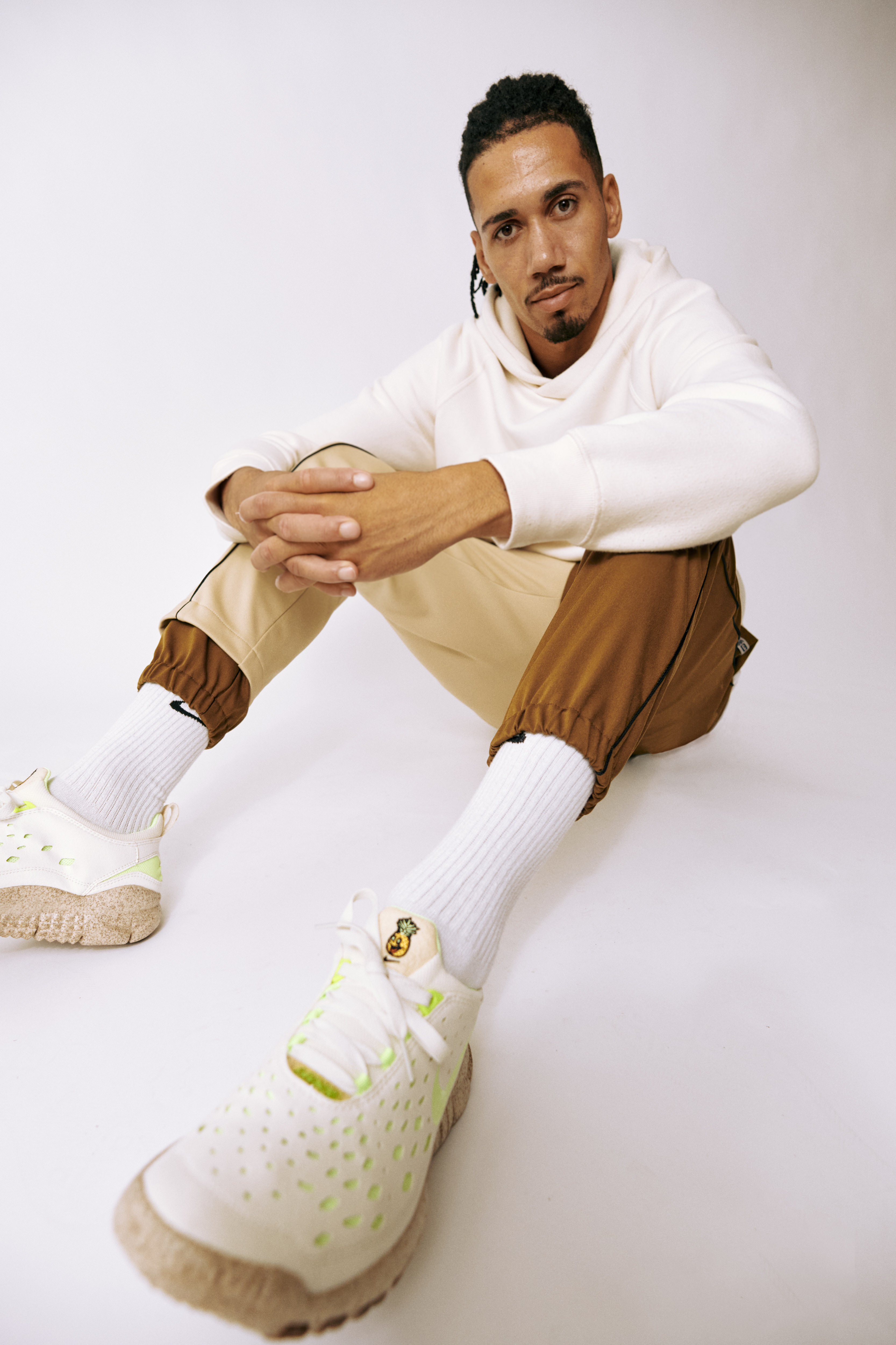 Footballer Chris Smalling wearing a pair of Nike sneakers from the Happy Pineapple Collection, which used pineapple leaves based Pinatex as a replacement to leather throughout the collection.