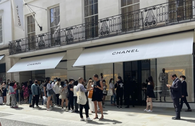 People queue up outside Chanel stores across London for new collection drop