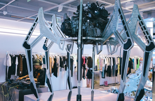 A large-scale robotic spider installation by visual artist Carlos Saez inside ENG store in Shanghai's TX Huaihai