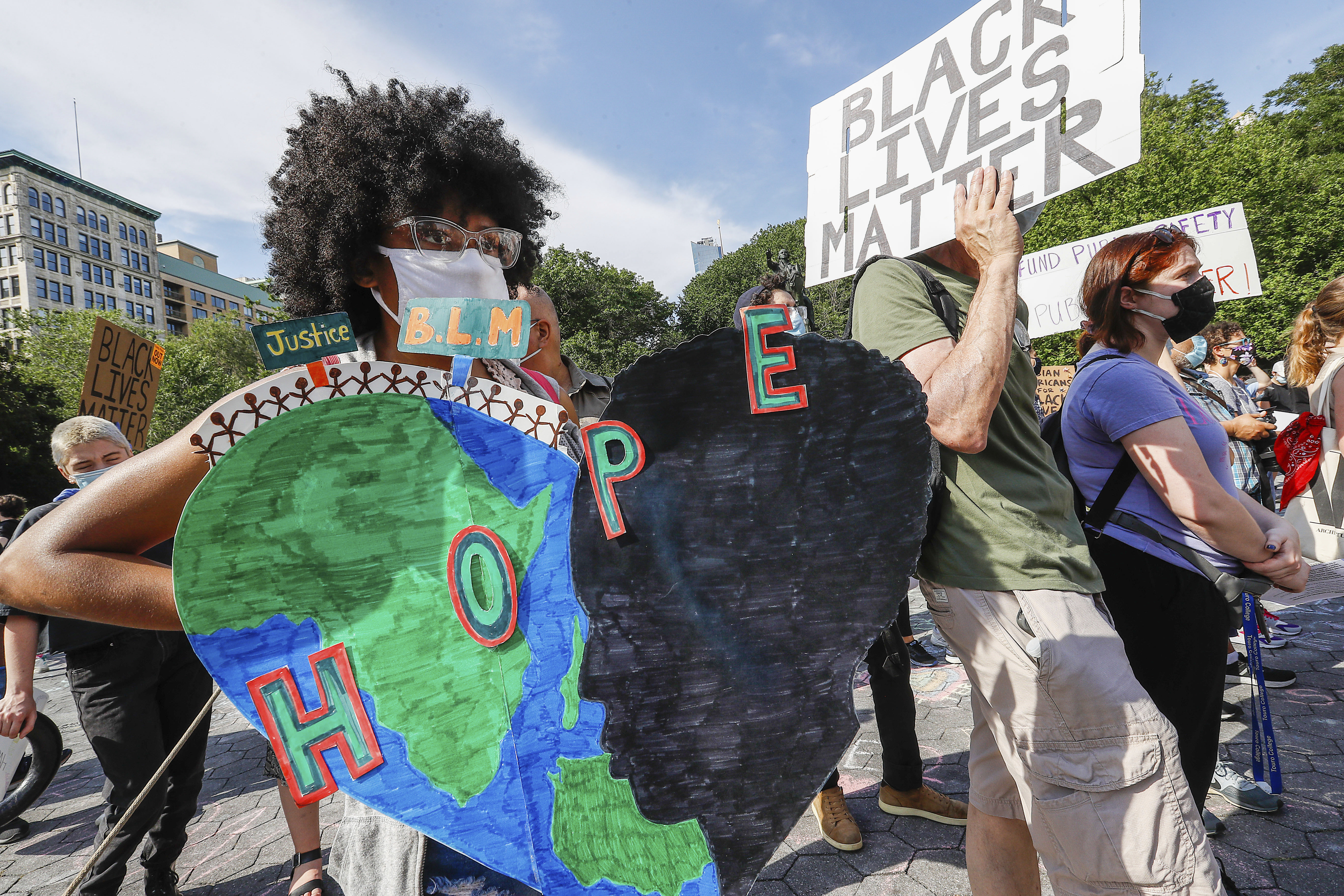Protesters hold placards during the demonstration. Hundredths demonstrate in New York against President Trump's Fascist KKKAMPAIN and Black Lives Matter march on Juneteenth weekend. Demonstrators continue to march against police brutality and racial injustice across America. (Photo by John Lamparski / SOPA Images/Sipa USA)(Sipa via AP Images)