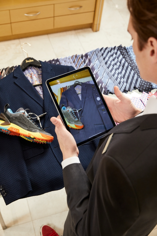 A Neiman Marcus style advisor using the retailer's CONNECT clienteling system.
