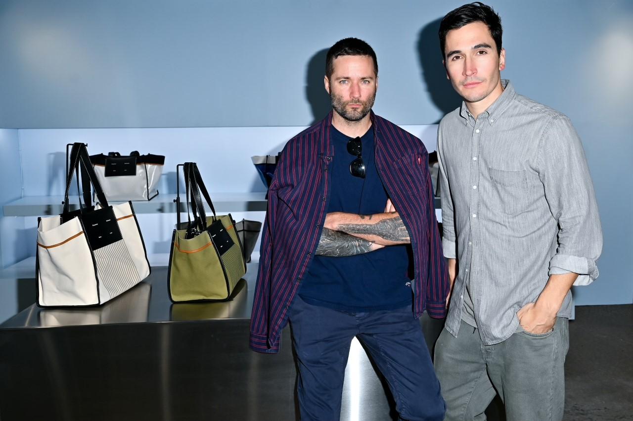 Jack McCullough and Lazaro Hernandez in the Proenza Schouler pop-up in the Hamptons.