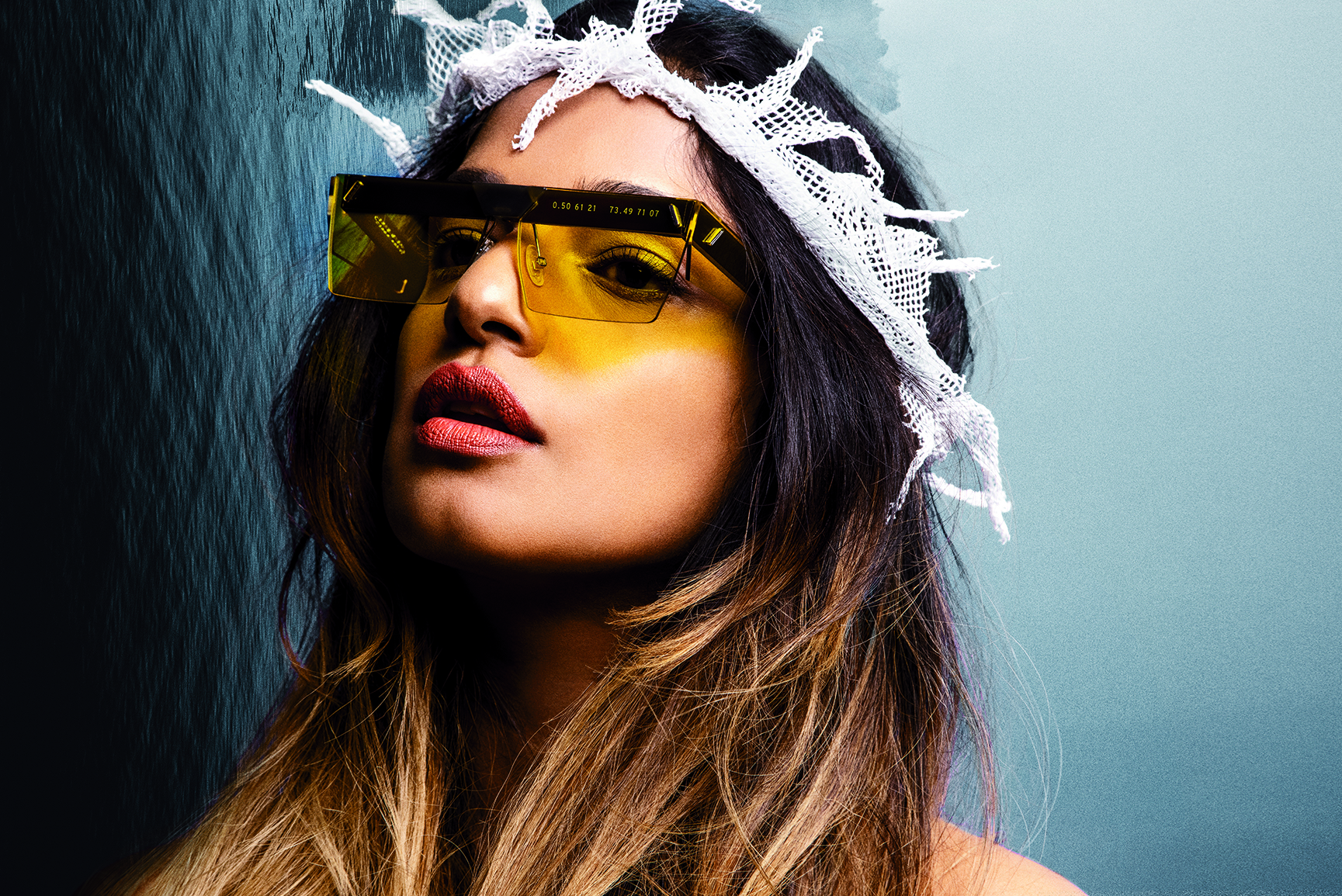M.I.A. wearing the sunglasses she designed with Parley for the Oceans's Clean Waves brand