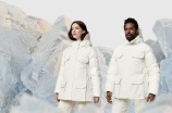 man and woman in white parka