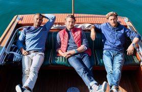 men wearing izod in boat