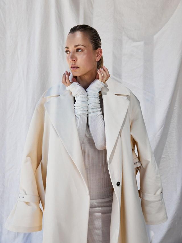 Jil Sander trenchcoat over GivenchyÕs wool dress and necklace.